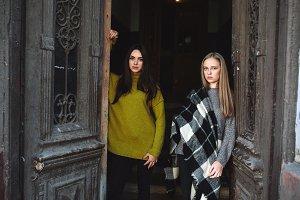 two beautiful women near the old doors