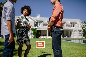 Young couple with real estate agent