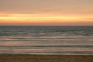 Blurred beach at sunset