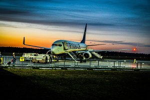 Ryanair plane in Warsaw with sunset