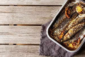 Cornish sardines. For grill and BBG. Dark background.