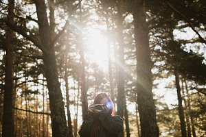 Woman with camera in forest