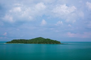 Tropical Island in Blue Waters