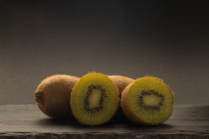 kiwis with black background