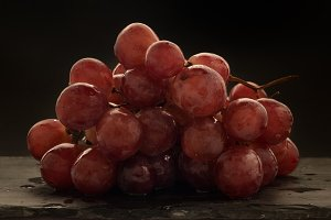 red grapes over slate plate