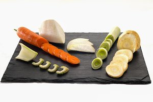 cutted vegetables over anslate plate