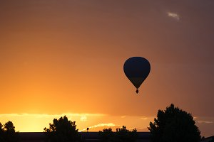 silhouette of a balloon at sunset