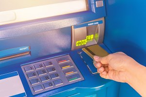 Hand insert credit card to ATM bank