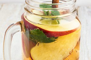 ice tea with apple,mint close-up