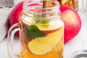 ice tea with apple in glass bottle