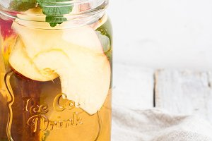 ice tea with apple,mint in glass mug