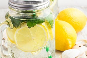 water with lemon,mint in glass mugs