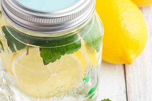water with lemon in glass mug