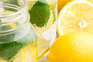 glass mugs of water with ice,lemon
