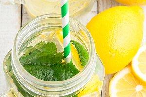 glass mugs of water with lemon,ice