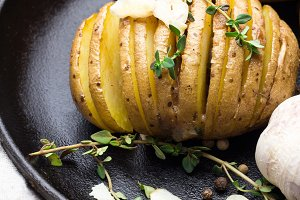 baked potato with thyme on pan