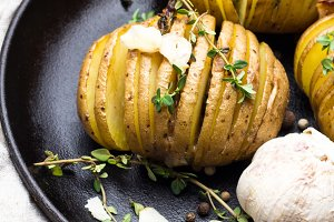 baked potato,garlic,thyme on pan