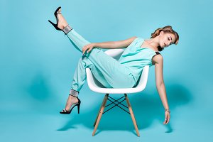 Woman posing on a chair.