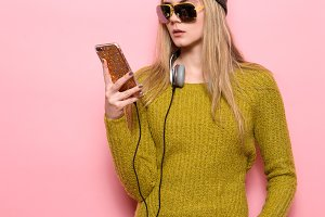 Hipster girl using cell phone
