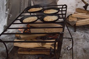 The pancakes are fried in a pan outdors - maslenitsa carnival