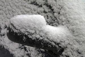 Snowy car mirror.
