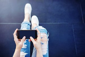 Hipster Girl using Smart Phone
