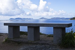Stone bench with seascape