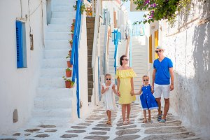 Happy family of four in greek village