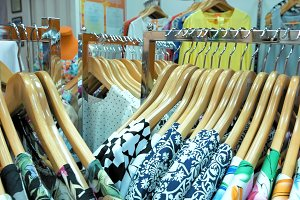 A clothing store is filled with summer garments