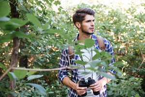 Portrait of male hiker in forest