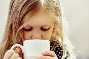 Child with tea cup