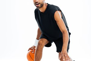 Portrait of a serious african sports man playing in basketball