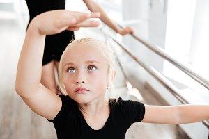 Beautiful little ballerina in ballet school