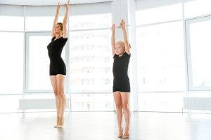 Little ballerina having class with personal ballet teacher