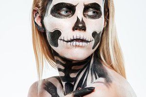 Portrait of young woman with gothic halloween makeup