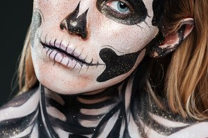 Closeup of woman with scared gothic makeup