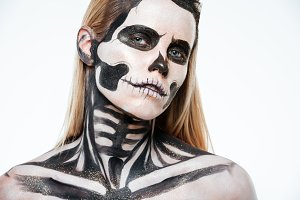 Closeup of woman with halloween skeleton makeup