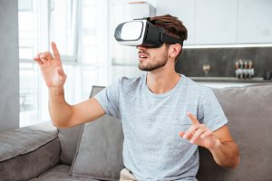 Young man wearing virtual reality device