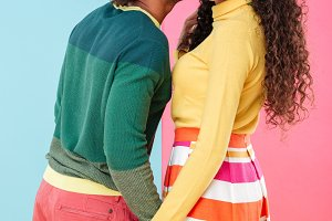 Happy african young couple kissing and holding hands