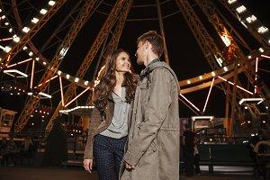 Portrait of beauty couple in amusement park