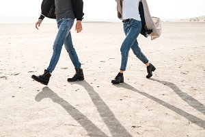 Cropped image of a couple standing together at the seashore