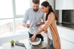 Couple cooked in kitchen
