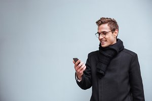 Business man looking at phone isolated