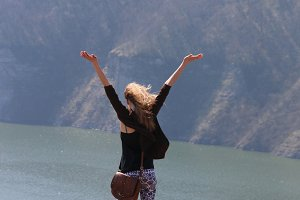Summer, Travel or vacation idea, free cheering woman open arms at mountain peak