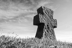 Black and white cross on grass