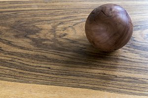 Wooden ball on wooden table