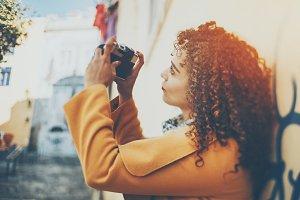 Tilt shift portrait of curly woman