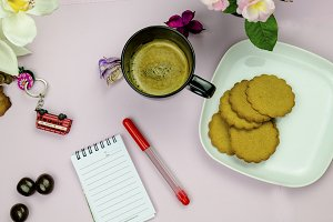 Notepad, coffee, cookies, chocolate