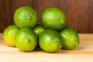 Limes on wooden table