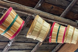 Baskets hanging in barn